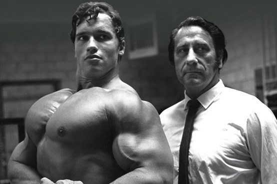 In 1968, at age 21, Arnold moved to the US with only $20 and very little English-speaking ability. He was brought under the wings of the late Joe Weider (pictured here) and soon became a bodybuilding star. But it wasn't all easy for Arnold. To make ends meet, he had to do odd jobs, including bricklaying.